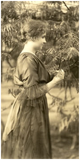 Picture of Helen in a garden.